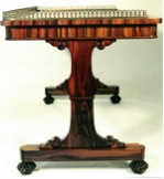 A pillar end writing table of about 1835-40, attributed to Gillows, of Goncalvo Alves wood. This design appears in Gillows Estimate Sketch Books. Private Collection