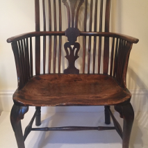 An 18th century Thames Valley cabriole leg comb-back armchair