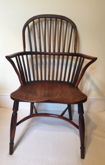 A 19th century yew wood Lincolnshire bow-back armchair